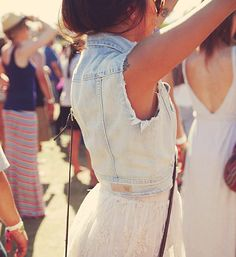 distressed denim vest with a girly skirt.