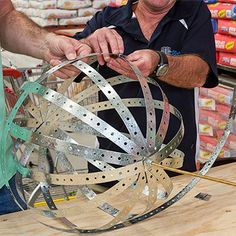 DIY garden globes made of metal strapping