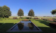 tuin tuinontwerp tuinarchitect hovenier hoveniersbedrijf tuinaanleg beplanting beplantingsplan onderhoud villatuinen spiegelvijver gazon landerijen