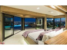 A contemporary master bedroom with priceless ocean and city views.  Coldwell Banker Residential Brokerage $8,888,000