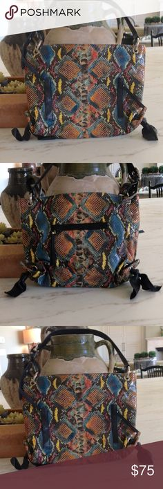 """Gorgeous CHEZ-Fine-Leather-Goods Python Tote, NWOT This is a gorgeous snake skin purse in all the colors I love.  It is NWOT.  It measures 14"""" x 11.5"""" and the strap is 20""""-26"""", depending on how you buckle it.  There are two small zippered pockets on one side and one large zippered pocket on the other.  The design of this purse includes leather tied ends on the bottom. So darn pretty and unique.  The inside is pink satin with Phone and makeup compartments and a zippered pocket.  I am pricing…"""