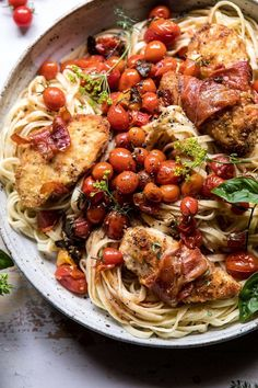 Prosciutto Chicken Parmesan with Garlic Butter Tomato Pasta. Chicken parmesan wrapped in crispy prosciutto mixed with garlic butter and herb roasted cherry tomato pasta. The end of summer pasta that's cozy, beautiful, and beyond delicious!