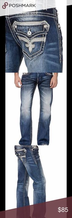 """Mens Rock Revival designer denim jeans """"dan"""" New With Tags  Retail Price: $189  Inseam: Approximately 33.5-34 inches  The Dan style jeans of the fashion-forward brand, Rock Revival. If you're searching for a look that's both stylish and edgy, Rock Revival Jeans are the exact fashion essential to compliment your rock-couture style.  Regular fit bootcut jean Stretch fabric  19 1/2"""" bottom opening Color pop stitch embroidery on faux flap back pockets Hand sanding, whiskering, grinding and…"""
