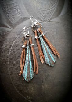 very rustic , wonderful and unique earrings, patina blue drops hang from aged…