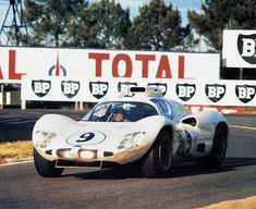 Phil Hill exits Arnage.The Chaparral squats under full power.  Although down on power to the Ford GT Mk.II cars, the 2D was still very fast, especially in the more technical portions of the circuit. Rainer W. Schlegelmilch photo.