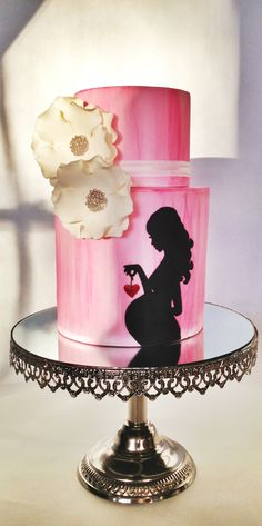 Pink baby shower cake with silhouette.