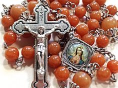 The Immaculate Heart of Mary Center on this rosary is beautiful.  #rosary  #rosaries