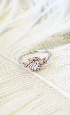 A golden halo engagement ring