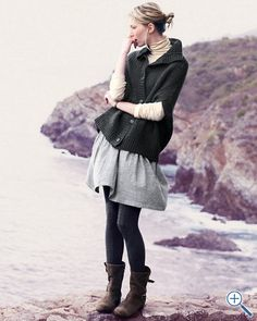 love this look: short sleeves over long sleeves, skirt, leggings, boots