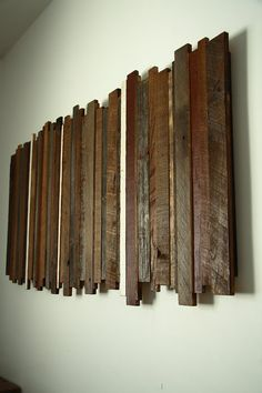 This artwork is constructed from reclaimed local barnwood that is over 80 years old. The artwork consists of multiple species of wood and each piece features the original paints. Each piece is hand selected for its character and natural patina to enhance the beauty of your piece.