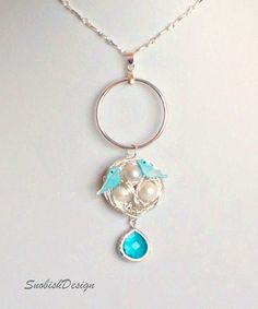 blue birds with pearl eggs and sterling nest.