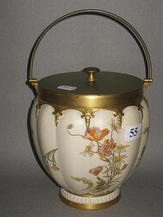 A Royal Worcester biscuit barrel, ivory ground with floral…