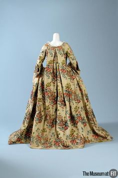 "Medium: Multicolored silk floral brocade Date: c.1735 Country: France or Italy A fashionable robe à la française might be made from yards of expensive silk brocade draped over wide hoops, trimmed with handmade lace, and elaborately accessorized. Often dismissed as wasteful, aristocratic luxury supported a host of artisans. According to the great French writer Baron de Montesquieu, there was ""an absolute necessity for luxury. Were the rich not so lavish, the poor would starve."""