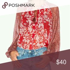 NWT. Free People long sleeve blouse. NWT. Free People boho peasant, long sleeve, multicolor super cute top. Tie around the front. Flowy and light very comfy! Size XS. Free People Tops Blouses