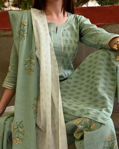 Shop online Mint Green and Sage Hand Block Printed Set - Set of Three Mint green and sage block printed pure cotton set with soft gota detailing on the sleeves and neck, paired with soft cotton pants and a simple yet elegant dual shaded dupatta. Printed Kurti Designs, Salwar Designs, Kurta Designs Women, Kurti Designs Party Wear, Casual Indian Fashion, Indian Fashion Dresses, Indian Outfits, Designer Kurtis, Dress Neck Designs