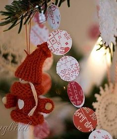A Christmas tree in red and white, loaded with homemade Xmas ornaments. See all the Xmas crafts for this tree here:  http://www.songbirdblog.com
