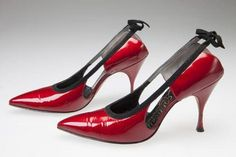 "Red patent leather stiletto heels, ca. 1965. Made by Caldwells. Missouri History Museum collections. In the early 1960s the stiletto took on a painfully narrow and pointy look at the toe, evident in these red patent leather shoes. The shiny ""wet look"" also became a trend in both shoes and clothing, as part of the new youth-centered space age and mod looks of the 1960s. Vote for these shoes in the Missouri History Museum's Artifact Madness…"