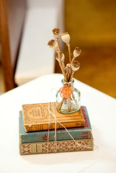 easy, DIY wedding centerpieces: vintage vase, dry flowers, ribbon & old vintage books ~ click for more from a DIY Montana Wedding