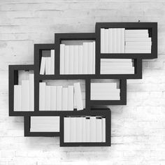 Frames Wall is a wall-mounted cluster of squares and rectangles that provide space for books of various heights.