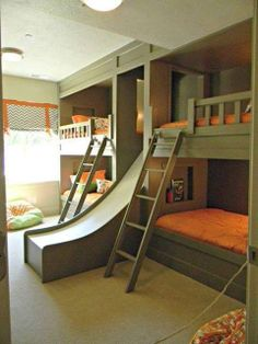 Bunk beds with a slide! I really, really love this idea! Love all the beds too! Hmmm maybe we'll just have to adopt a couple more times