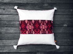 The traditional fabric called Endek is woven using the ikat method. The effect creates an irregular, zigzag and wavy look to the pattern.  #cushions #ikat #ikatcushions #decor #homewares #anotherland