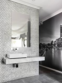 """The T-wall of hexagonal marble tiles Maddi and Lloyd created, from House Rules in Australia, in Adam and Lisa's enuite was a top five moment for judge Wendy Moore. """"I loved the wall-hung basin in the centre – it looked amazing,"""" she says."""