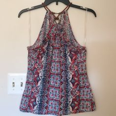 Tank top Pretty CHAPS red, white and blue patterned top with center ring and braided leather cord. Keyhole back with lobster clasp closure. 100% cotton. Chaps Tops Tank Tops