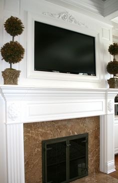 TV above Fireplace Mantel built by Thomas Homes, Inc.