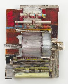 Printed Matter 40 x 30 x 3 inches. International newspapers, mixed paper, corrugated cardboard, paint, graphite, wax.