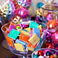 Arrange colourfully wrapped chocolates and Christmas tree baubles in glass bowls and jars for a cheap and chic way to decorate your home.