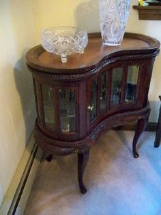 "Antique 1940's kidney shaped mahogany curio with removable table top!  Sometimes called a ""Tea Cabinet"" ... the top is a ""serving tray"" ... Great Condition!"
