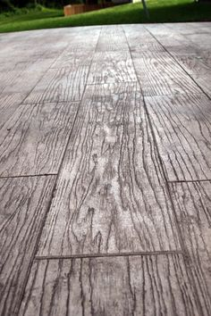 wow, i'm obsessing over this idea - stamped concrete to look like wood or stone. definitely an option for a patio. Love this idea
