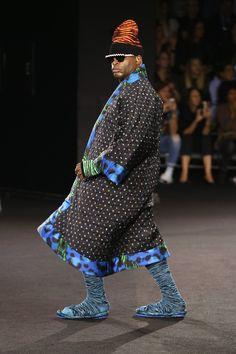 NEW YORK, NY - OCTOBER 19:  A model walks the runway at the KENZO x H