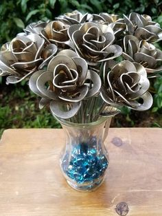 You have found the Perfect Valentines Day gift for him or her! Handmade welded metal roses create the perfect gift. One dozen up-cycled roses made from recycled washers and wire welded together creating beautiful art. Each rose is an individual and a little different all created from the