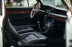interior - shoot from outside, ope car door. focus on gear know. not so shallow DOF. maybe around 6 or 7?