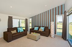 Blue and brown! A funky striped feature wall steals the show in this living room.