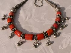 Necklace made from beautiful old silver pieces from an old necklace from Yemen that have been combined with contemporary coral beads. ~ Anne Marie of BeadArt Austria