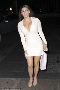 Showing off: Glamour model Casey Batchelor flaunted her sizable bust in a plunging cream mini dress