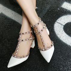 - Sexy t strap rivet heels for the modern fashionista - Lovely rivets with t strap design offers a stylish look - Great for the workplace or social events - Made from PU - 7 cm heel height - Available in 3 colors