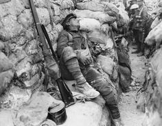 A British soldier catches up on some sleep in a front line trench at Thiepval in…