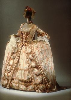 Robe a la francaise [French] (C.I.61.13.1a,b) | Heilbrunn Timeline of Art History | The Metropolitan Museum of Art    I want the rose trim displayed next to the openings of the skirt, like the trim is here.  I also like the lace sleeves and neckline detail.