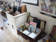 A canal boat filled with words. Literary greats out on a cruise together… a delightful world filled with small knick-knacks like antique typewriters, a sewing machine, some old suitcases, and…