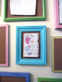 Framed cork boards for ever-changing artwork by children. Such a cute idea