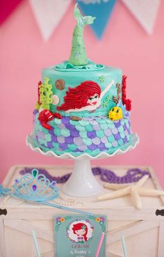 Loving the birthday cake at this Little Mermaid Birthday Party! See more party ideas and share yours at CatchMyParty.com