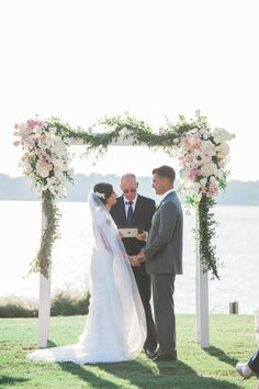 Blush and Ivory Flower-Decorated Wooden Wedding Arch