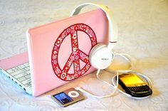 Pink laptop + white headphones