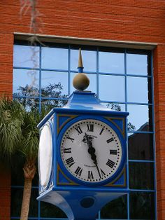 Hernando County Clock-  On the side of the Hernando County Government building in Brooksville,Fl.   I loved the blue, reflections of Florida and a touch of moss. Quality Prints Available.