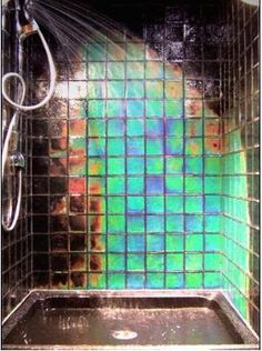 hypercolor shower tile. changes color with heat. price is approximately $180 per square foot of 4x4 glass tile. making it the world's most ridiculously priced tile. but it's awesome, huh?