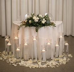 Candles and rose petals add the whisper of romance to the Head Table Candles and rose petals add the Head Table Wedding Decorations, Head Table Decor, Head Tables, Deco Table, Decoration Table, Wedding Centerpieces, Tall Centerpiece, Bridal Table, Wedding Table