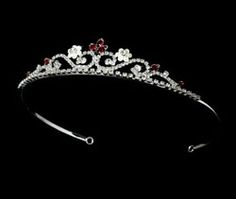"""SILVER & RED TIARA Sweetly floral, this lovely silver plated tiara dazzles with red rhinestones, ivory faux pearls, and a simple curl pattern. The perfect bride's, bridesmaid's, or flower girl's accessory to your classic or modern wedding. Size: The ornamented portion of the piece measures 6-1/4"""" wide and 1"""" tall, and the piece ends in two loops that allow you to fasten it in your hair with bobby pins. Available in:See site for choices Price: $44.99"""